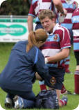 Becky treating Rugby player